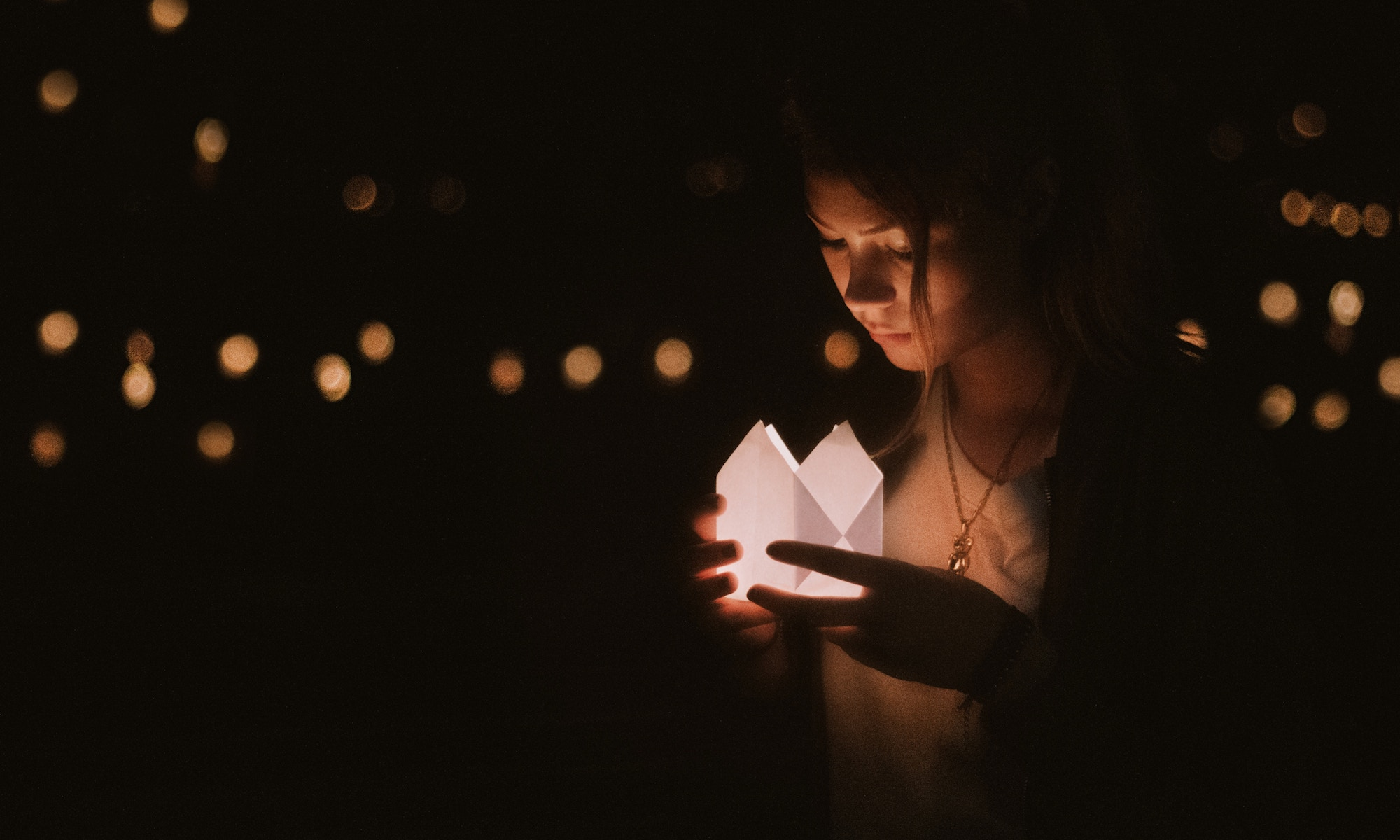 Empathy: Grieving teen with paper lamp