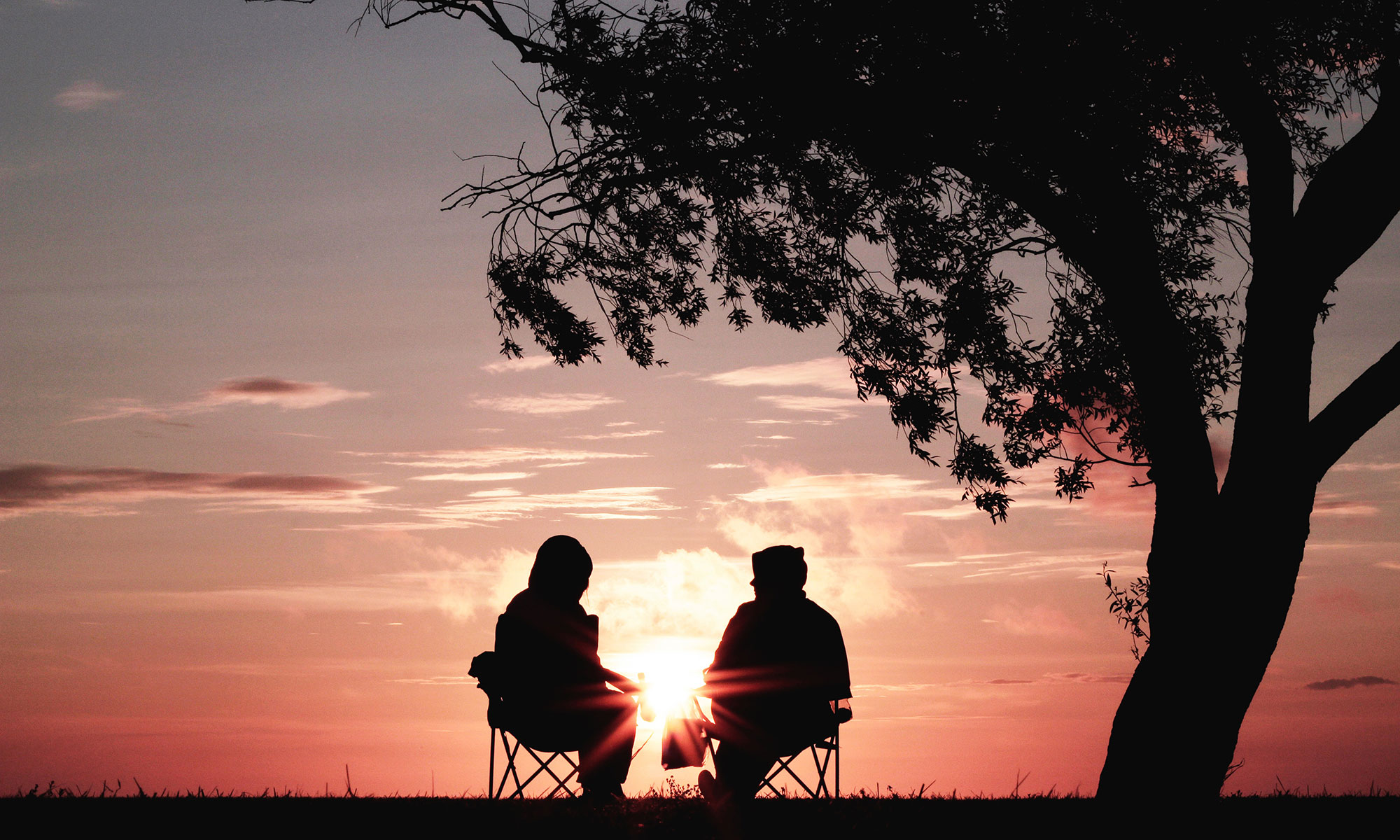 Two people together at sunset
