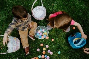 Children playing with plastic Easter eggs